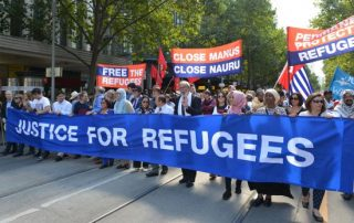 MELBOURNE, AUSTRALIA - MARCH 20:  Thousands of Australian have taken to the streets of Australia during a protest demanding that refugees not be send back to Nauru or Manus Island on March 20, 2016 in Melbourne, Australia.  (Photo by Recep Sakar/Anadolu Agency/Getty Images)